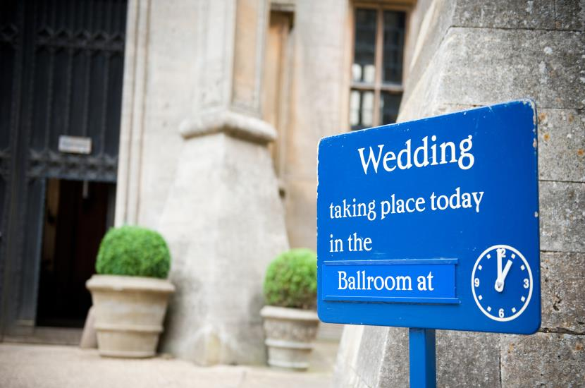 Professional photograph of front of Belvoir Castle on a wedding day